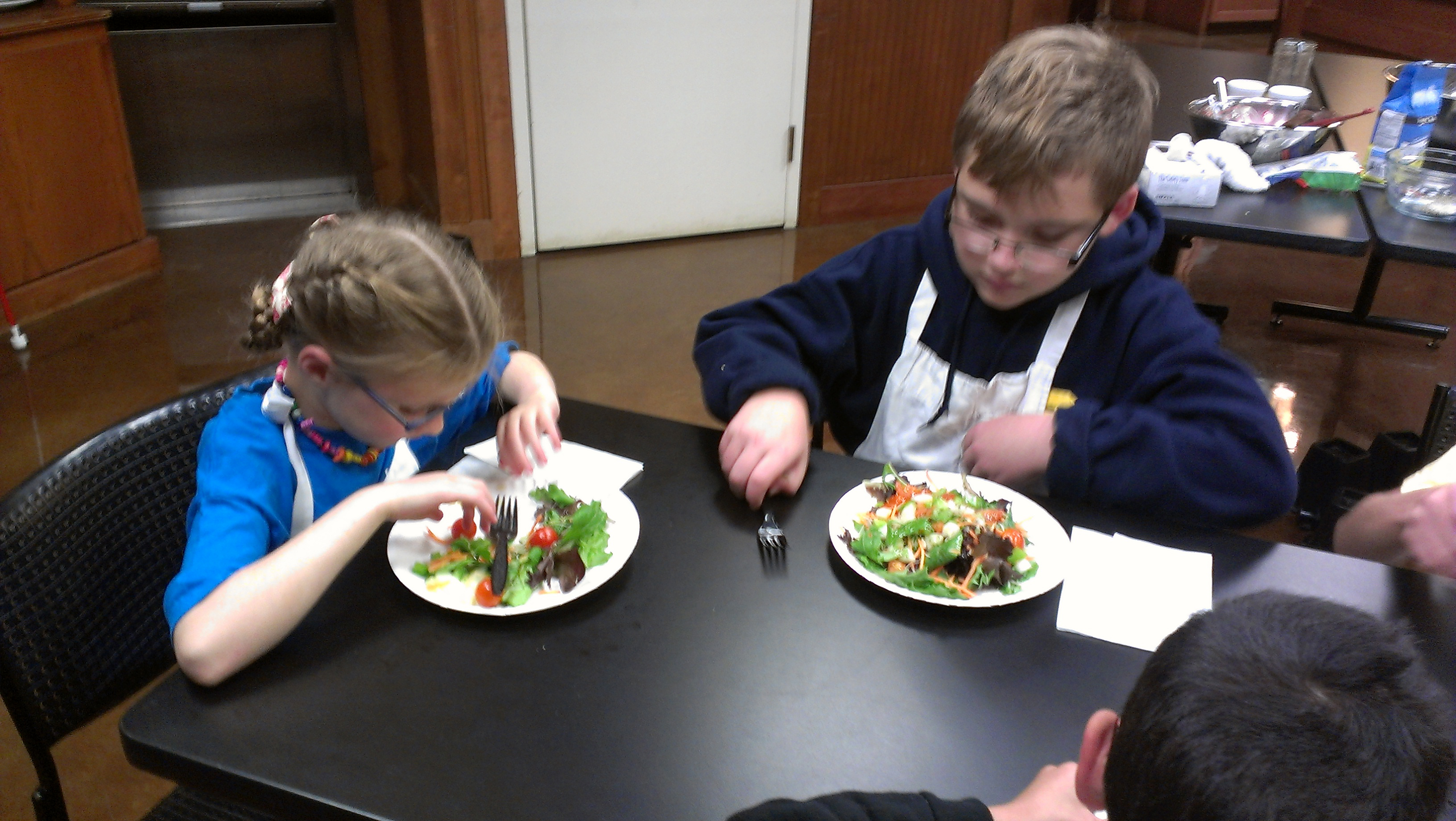 Students eating what they cooked.