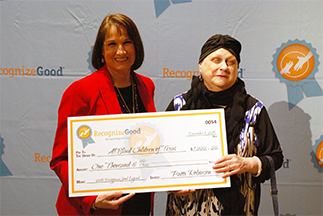 Patti Robinson and president Mary Sue Welch with the large $1,000 check